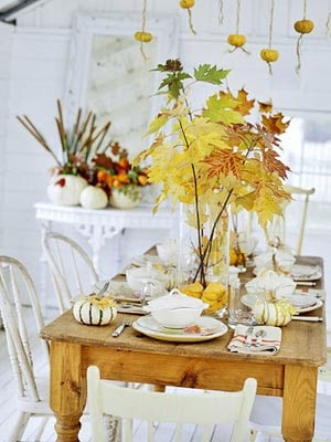 table with tree branches centerpiece