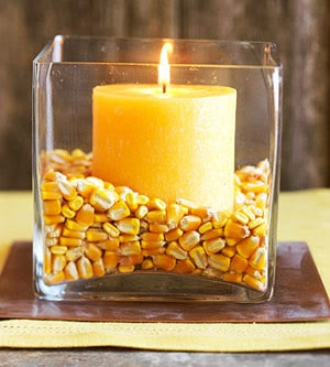 candle in corn in vase
