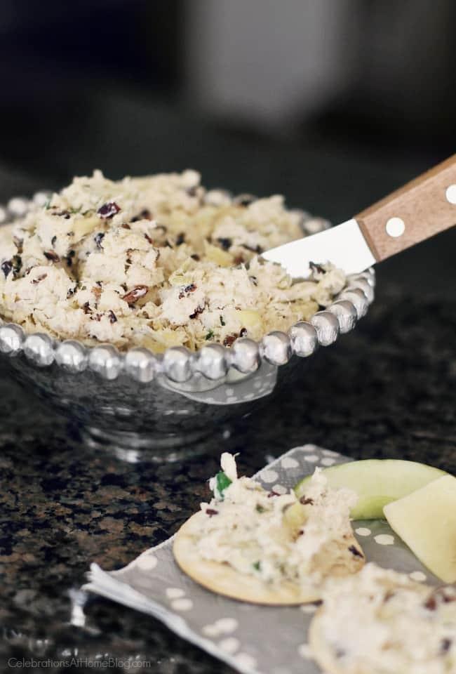 chicken artichoke cheese spread recipe in silver dish with knife spreader
