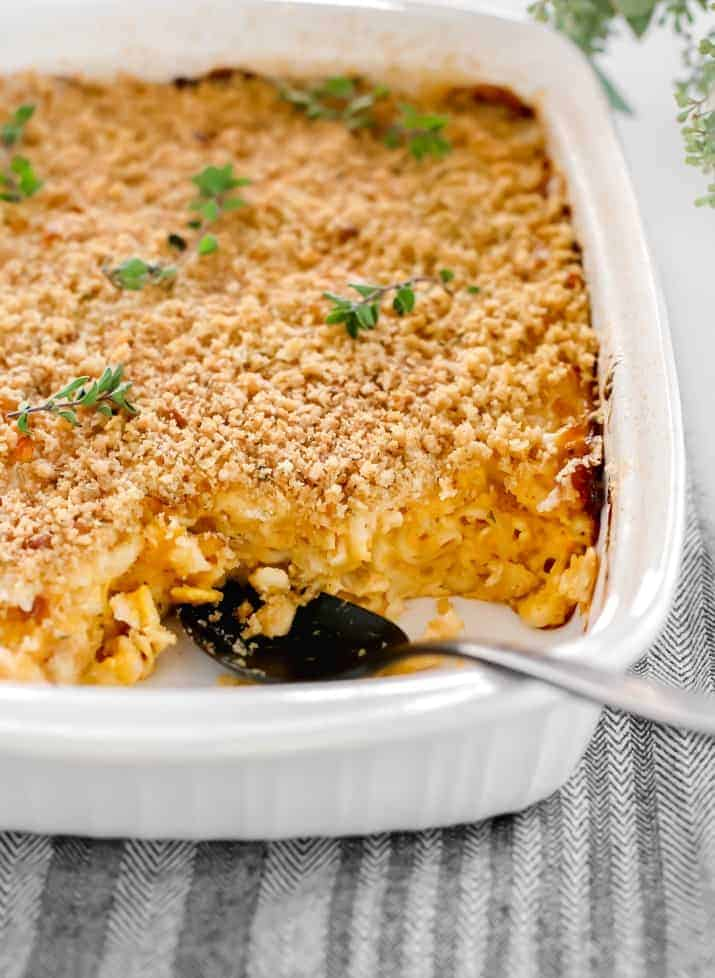 Creamy Homemade Mac-n-Cheese Recipe, in white dish with scoops taken out