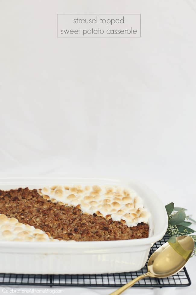 This Streusel Topped Sweet Potato Casserole is a recurring dish at our holiday gathering table. It's got the best of both worlds with streusel topping AND marshmallows! Get the recipe here. #sidedish #sweetpotatoes #Thanksgiving #Thanksgivingrecipe #holidayentertaining