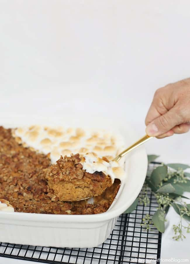 This Streusel Topped Sweet Potato Casserole is a recurring dish at our holiday gathering table. It's got the best of both worlds with streusel topping AND marshmallows! Get this holiday side dish recipe here. #sidedish #sweetpotatoes #Thanksgiving #Thanksgivingrecipe #holidayentertaining