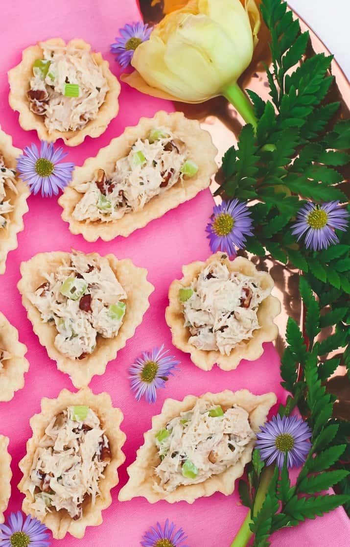 honey chicken salad cups party food, on pink background