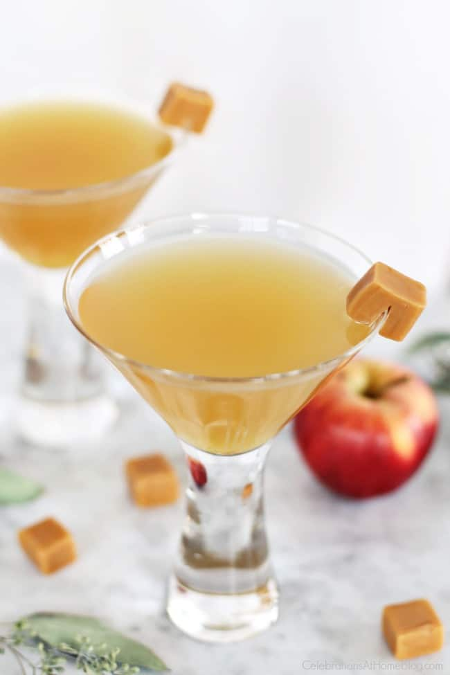 Autumn Cocktails Caramel Appletini recipe in two martini glasses with caramel square garnish