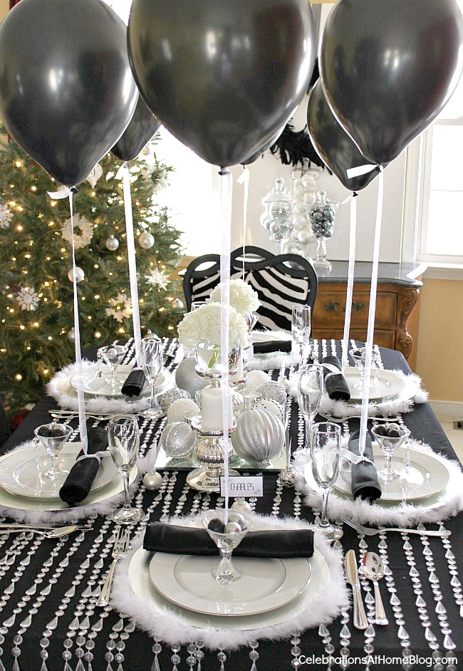 This black & white & silver holiday table will inspire any glamorous celebration including birthdays, anniversaries, even weddings!