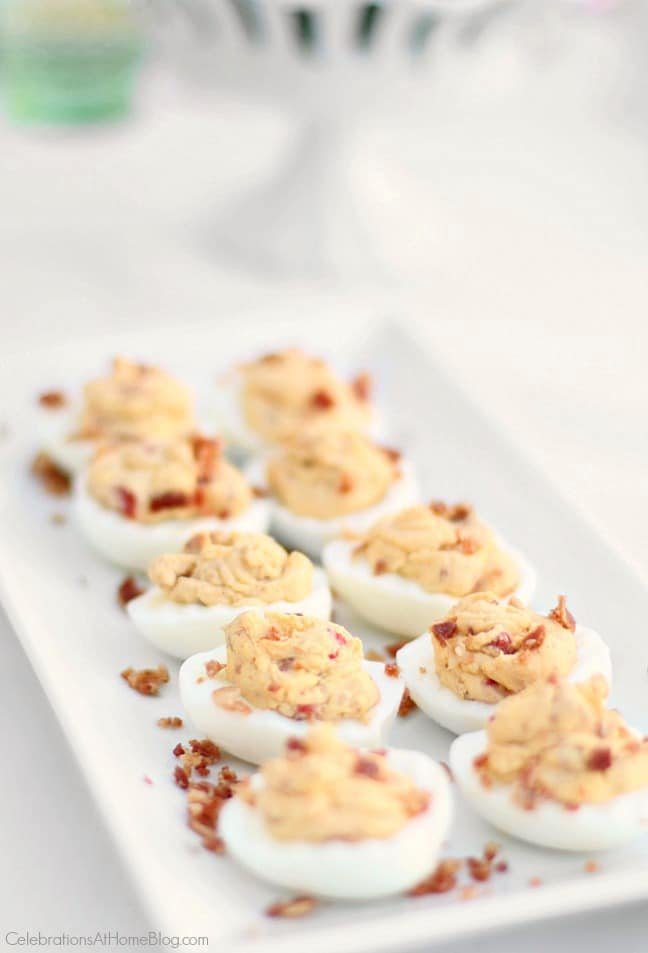 These delicious deviled eggs with bacon are my go-to recipe. They're tangy, full of flavor, and have some surprising ingredients. Serve them on your Easter brunch or dinner table.