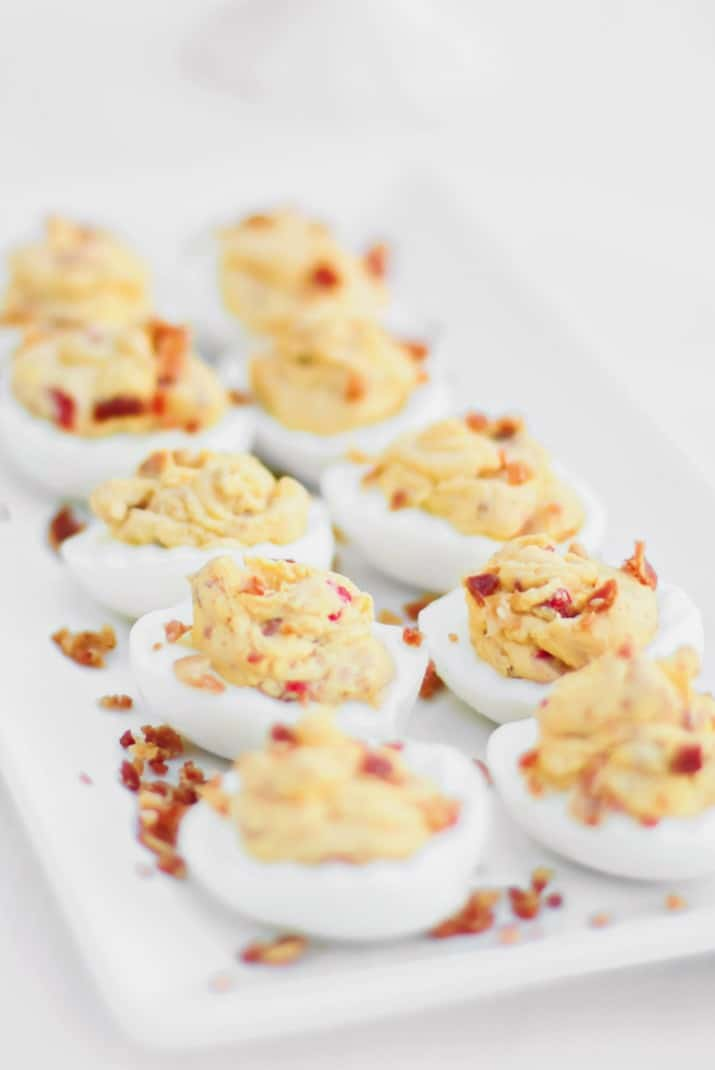 Delicious Deviled Eggs With Bacon recipe on white dish
