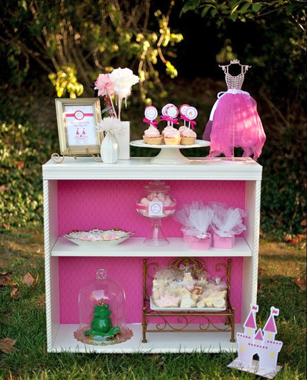 pink princess tea party shelf with princess themed desserts