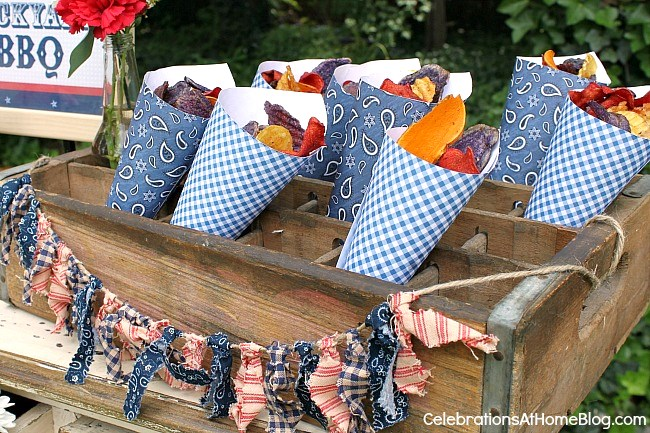 Set up a welcome table for your summer bbq and have snack cones filled with colorful chips.