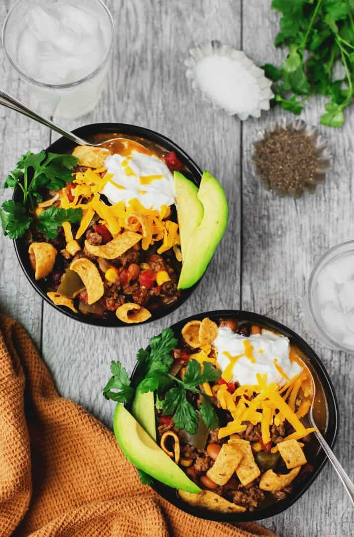 easy slow cooker fiesta chili recipe in two black bowls
