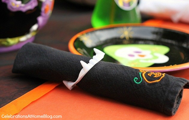 See Halloween themed food and costume party ideas here. - fang napkin wrap