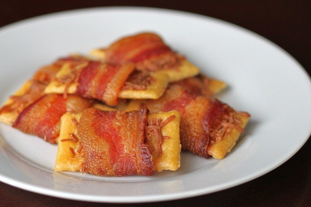 bacon wrapped club crackers on white plate