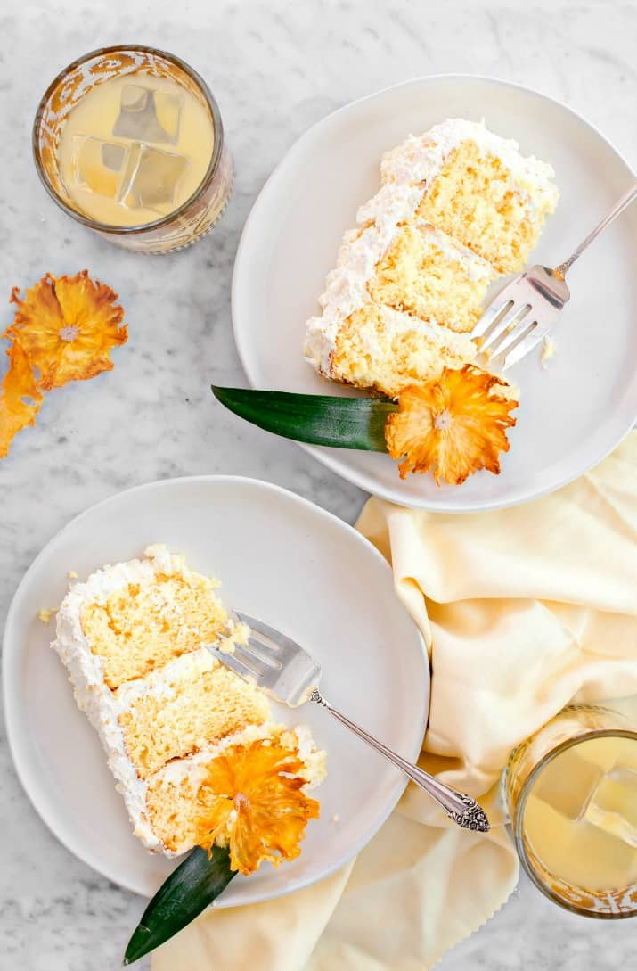 pineapple white layer cake slices on white plates