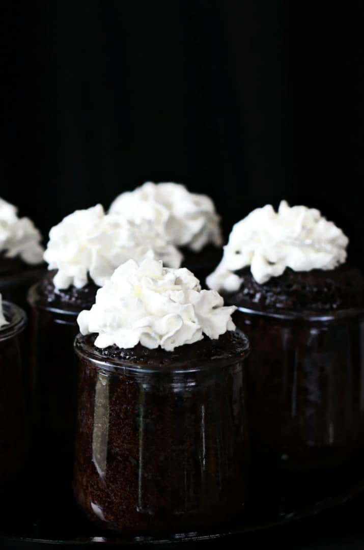 microwave chocolate cakes in a jar with whipped cream