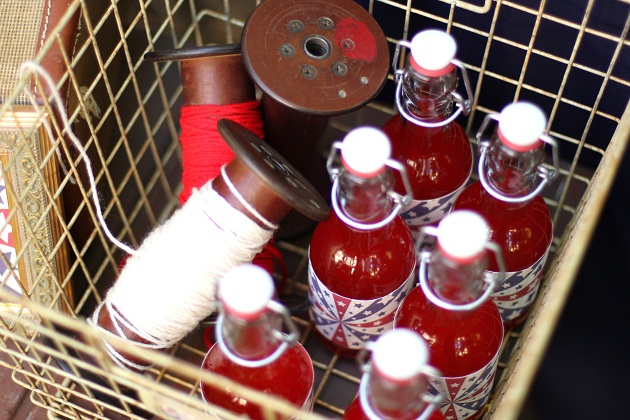 4th of July party ideas mini bottles of red soda in a wire basket
