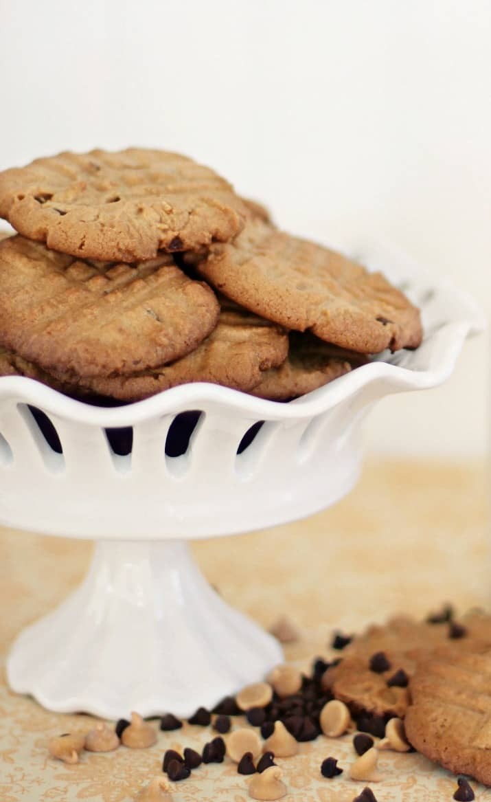 best double chip peanut butter cookie recipe, cookies stacked in white dish