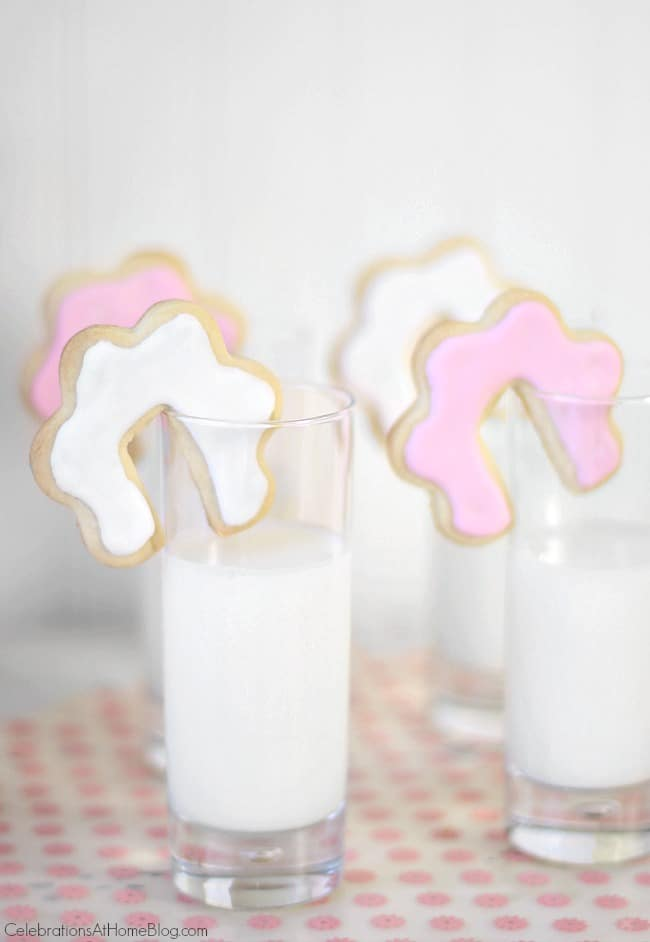 cutout cookies on rim of milk glass