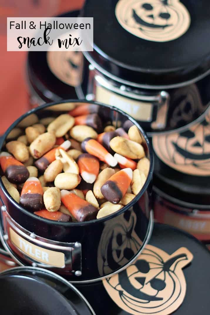 Halloween candy corn snack mix in black tins
