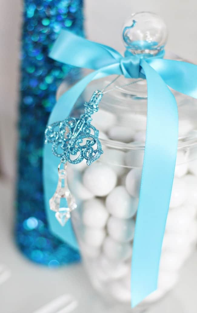 ornament hanging on candy jar, elegant holiday dessert table