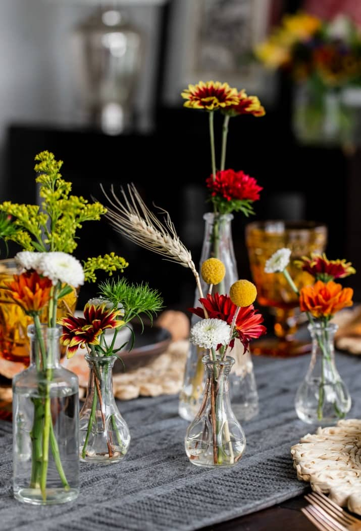 bud vases filled with fall flowers
