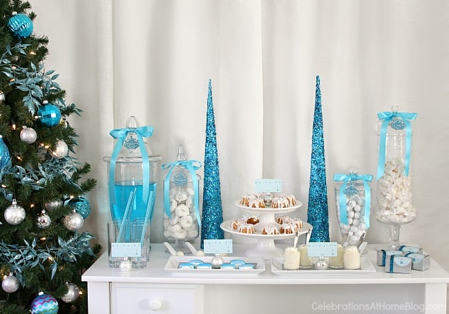 Elegant holiday party ideas in blue and white for a modern Christmas celebration or even Hanukkah.