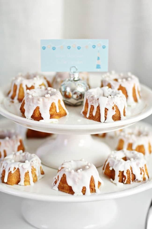 mini bundt cakes look like snow covered mountains on elegant holiday dessert table