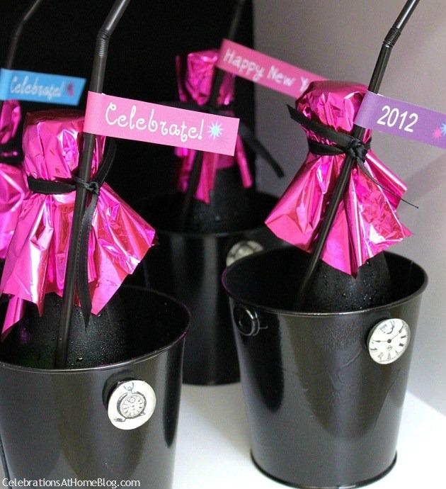 mini champagne bottles in mini ice buckets