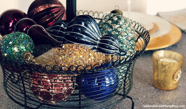 Christmas ornaments stacked in wire basket