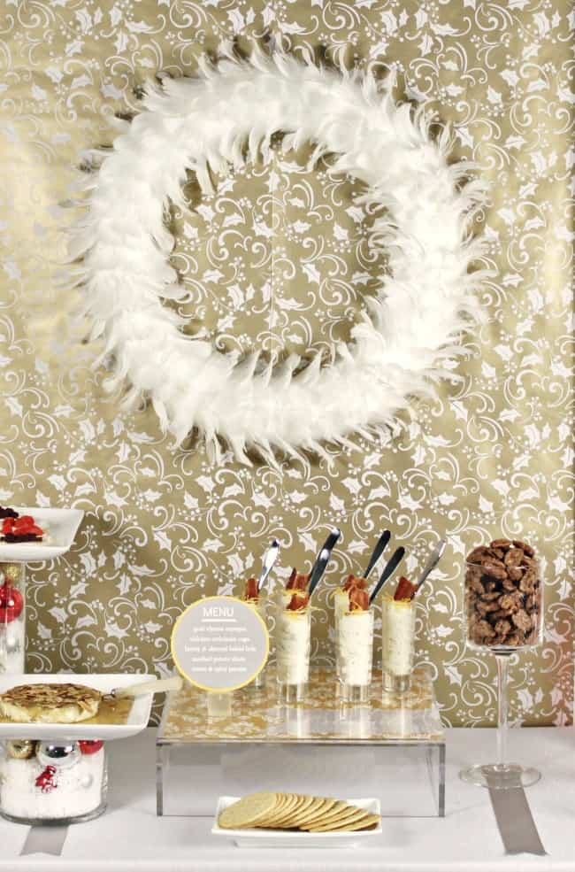 Christmas Cocktail Party Ideas with wrapping paper backdrop