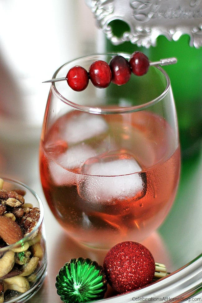 """Make this red Christmas cocktail and call it """"Rudolph's Shiny Red Cocktail"""". Serve it at your Christmas party or holiday soiree."""