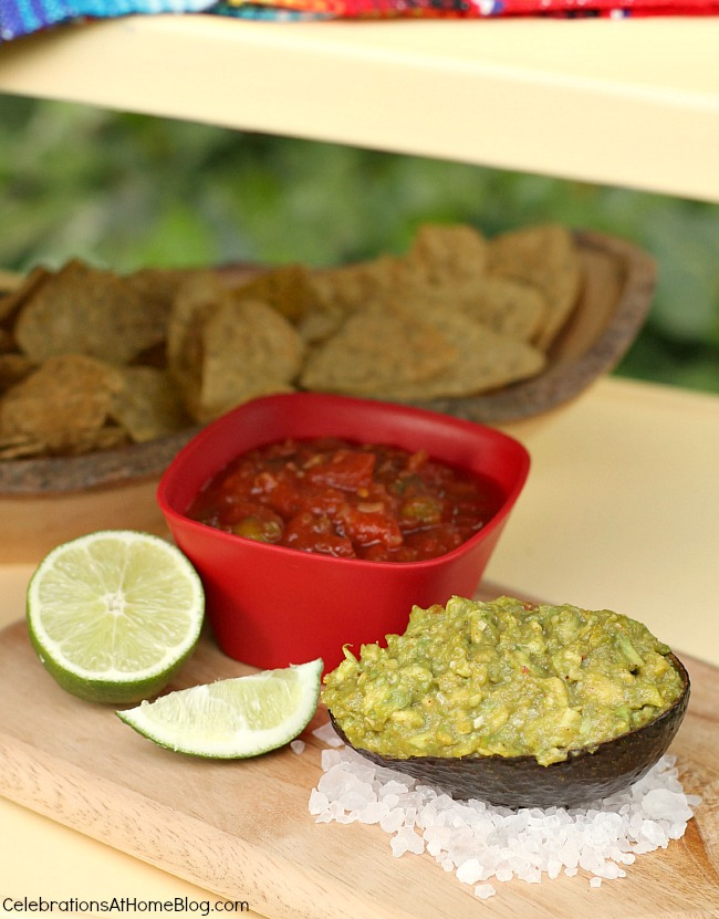 """cindo de mayo party ideas - serve guacamole in an avocado """"bowl"""" and place on a bed of rock salt to keep it level"""