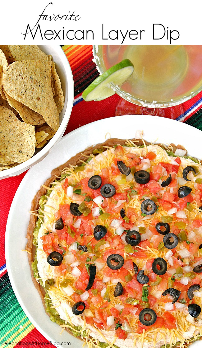 Get my FAVORITE Mexican layer dip recipe. It has a twist that I haven't seen elsewhere. It's a party favorite with guests too. Serve it for Cinco de Mayo, game day, backyard bash, etc.