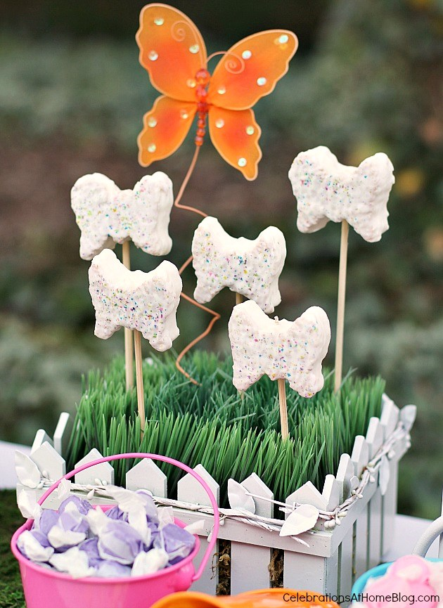 "Make a ""butterfly garden"" of iced butterfly cakes inserted into grass-covered foam."