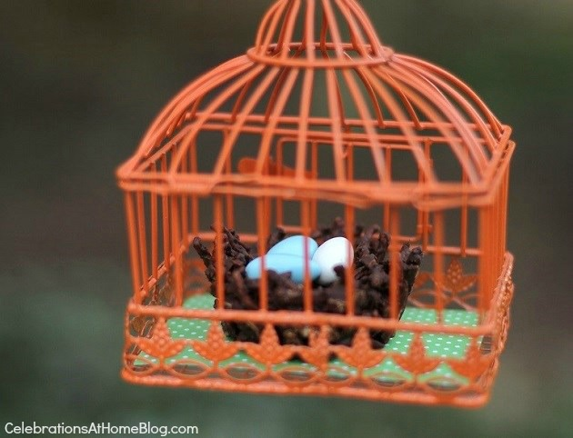 chocolate birds nest inside hanging bird cage