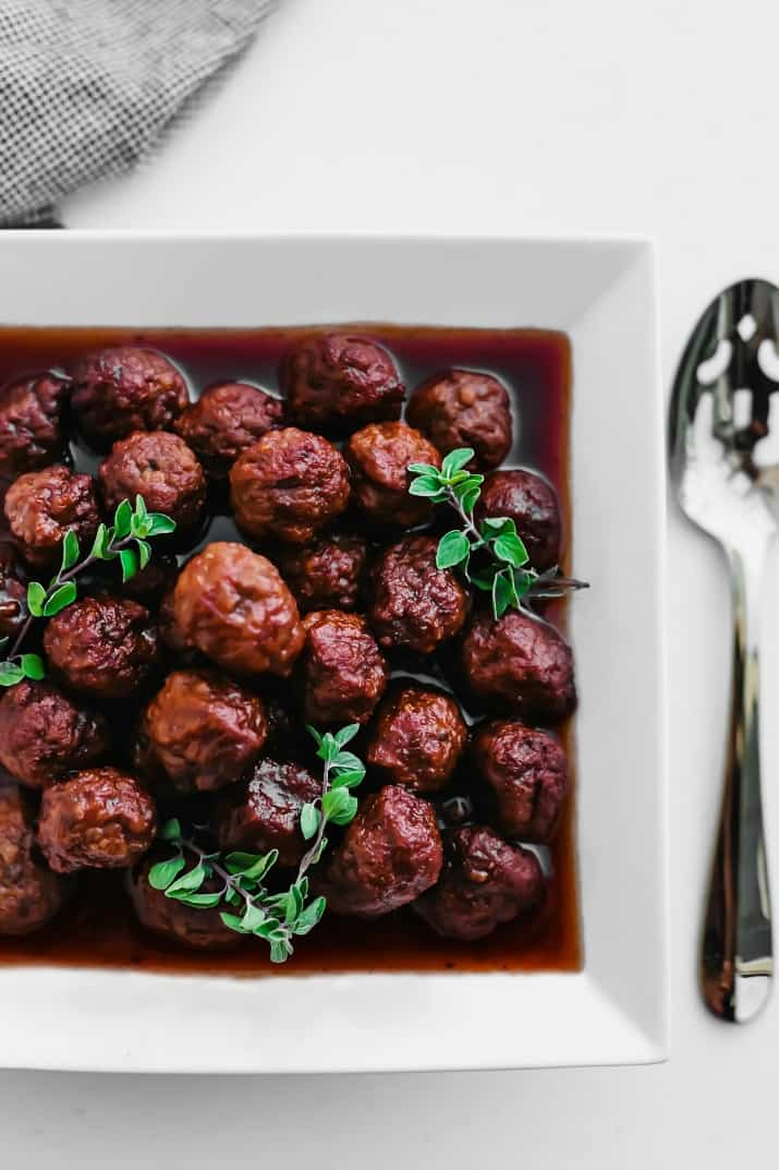 bourbon meatballs in white bowl overhead view