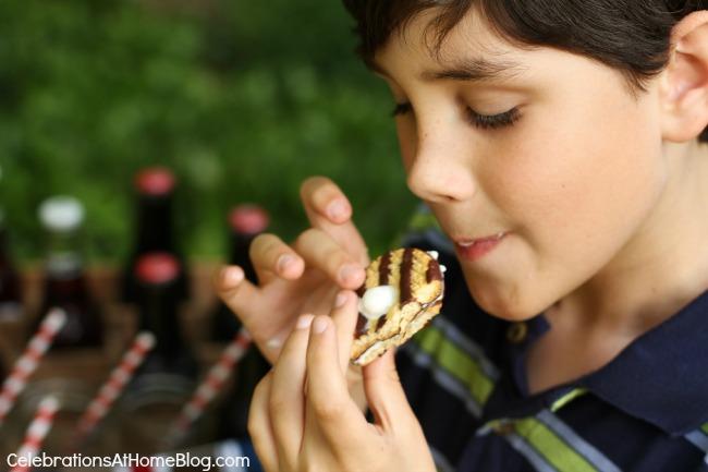boy eating ice cream cookie sandwich