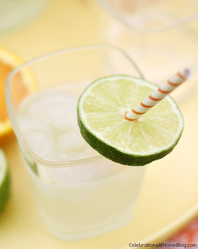garnish your drink with a straw pushed through a lime wheel