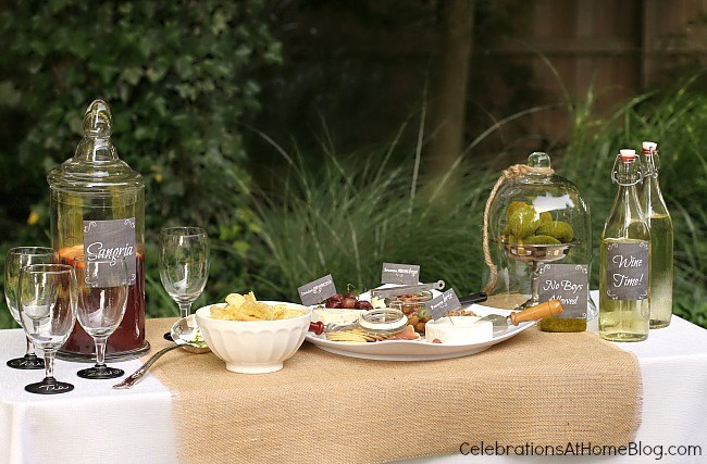 Set up a wine and cheese table for outdoor entertaining.