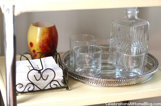 cocktail napkins, glasses and tray on bar cart