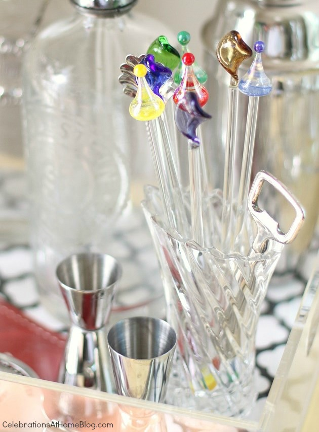colorful drink stirrers on bar cart