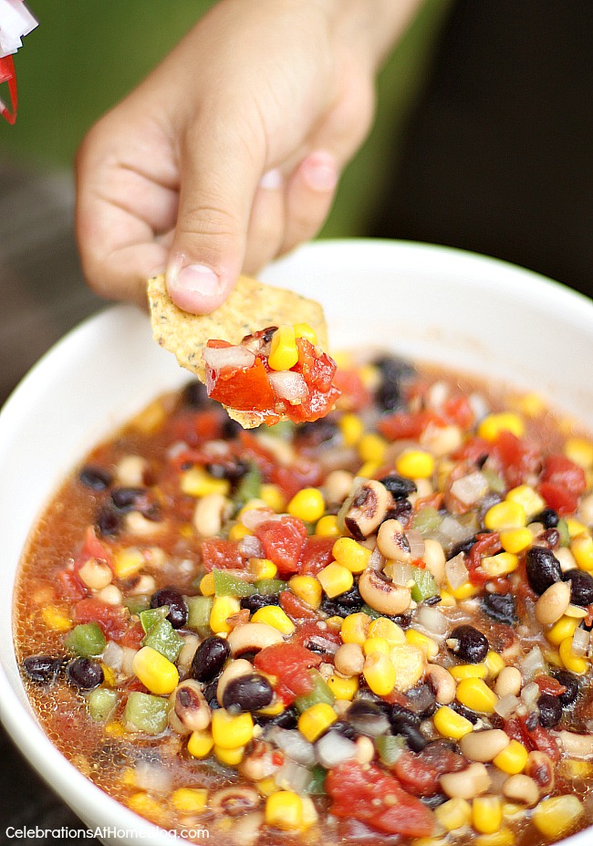 Make this easy bean and corn salsa the night before, or about 8 hours earlier than you need it so the flavors have time to marry.