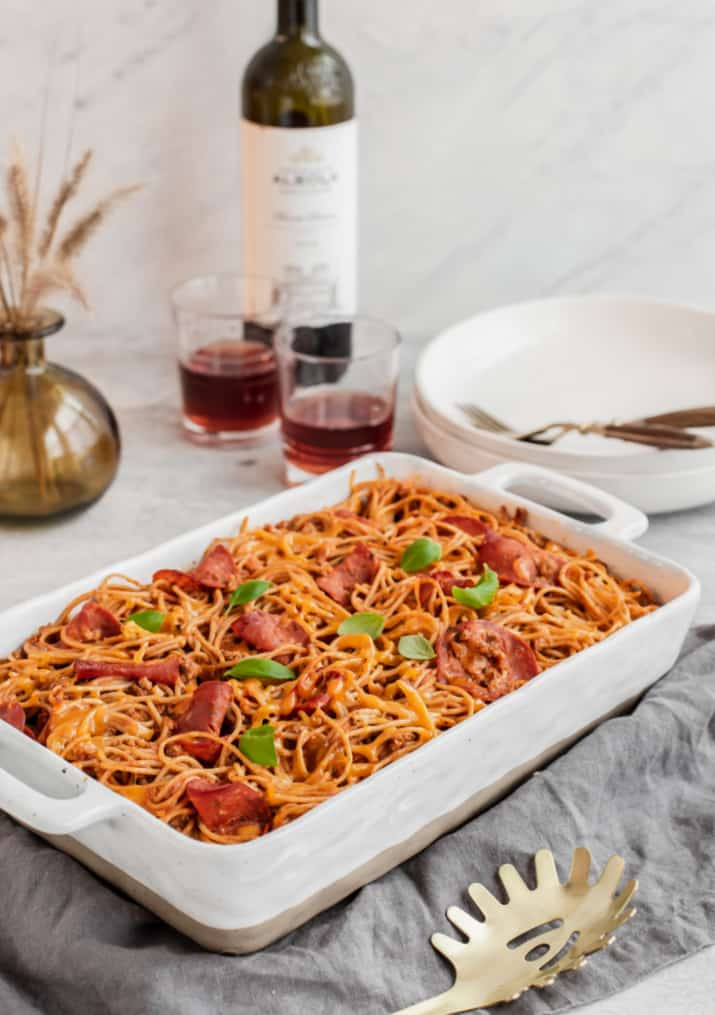 baked pasta with wine on gray table