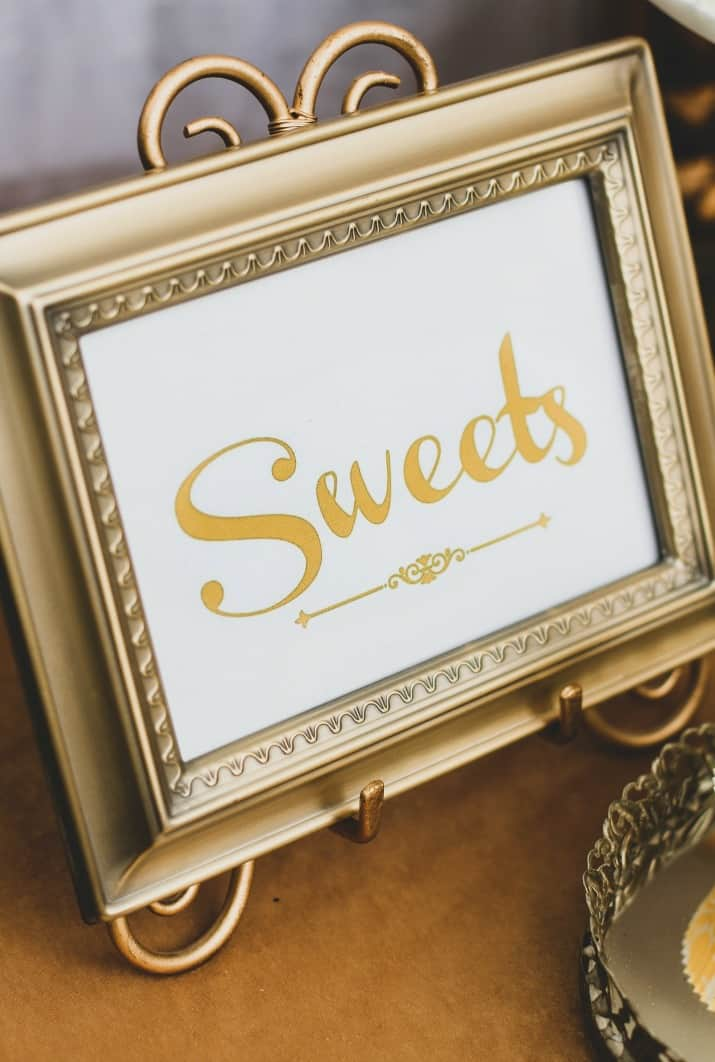 framed sweets table sign