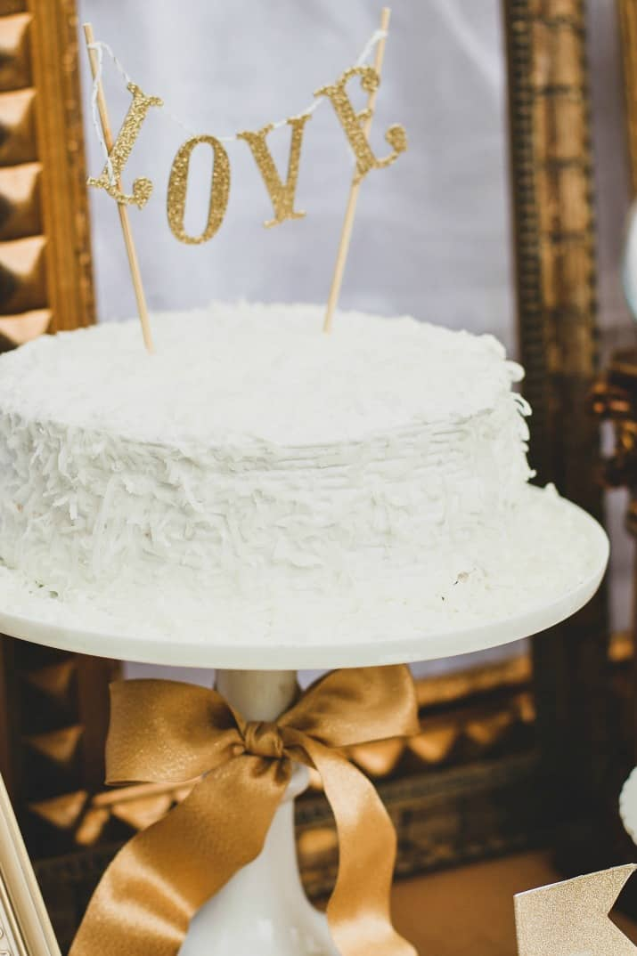 coconut cake with diy gold banner topper