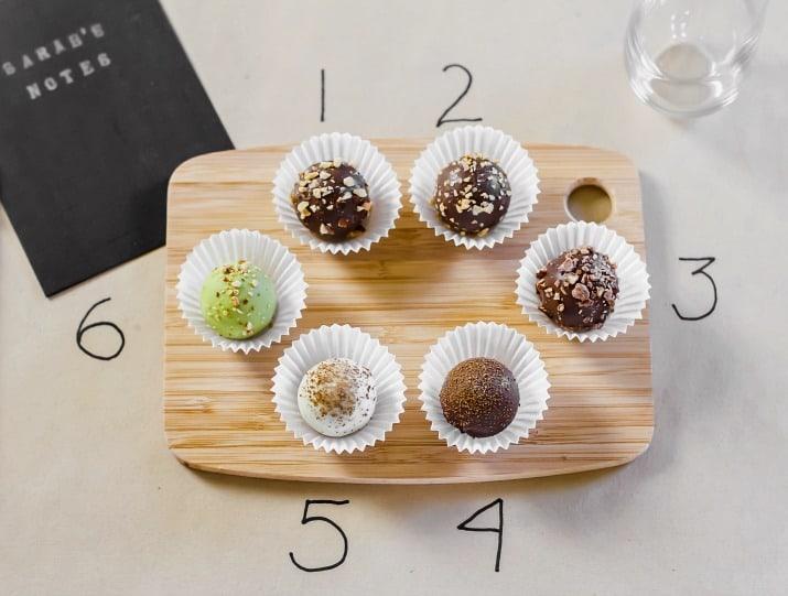chocolate truffles on wood board