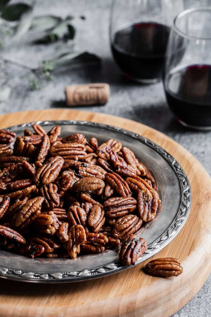 seasoned pecans on silver tray on gray table