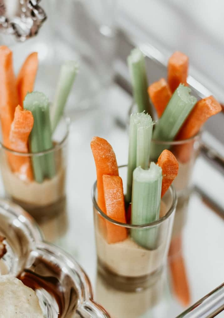 carrot and celery sticks in mini glasses with dip