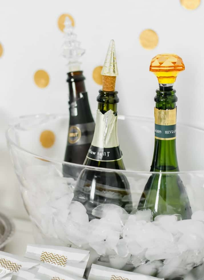 bottles of champagne on ice in bucket, ideas for setting up a bubbly bar