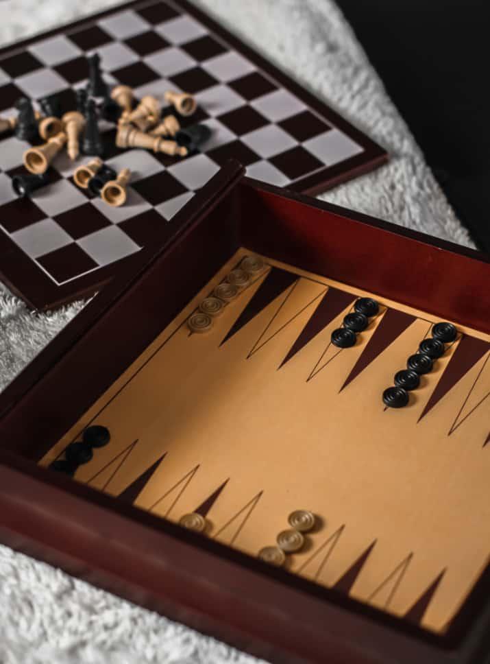 backgammon board and checker board on table