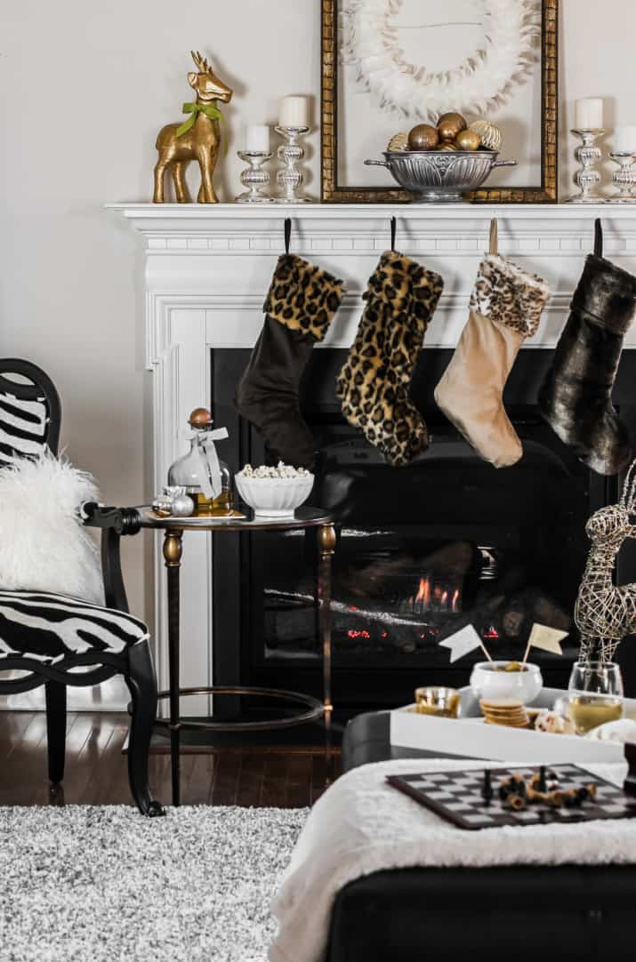 animal print Christmas stockings on mantel in neutral living room